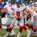 Giants' Daniel Jones displays strong arm,...
