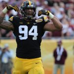 New York Giants select pass rusher, center in...